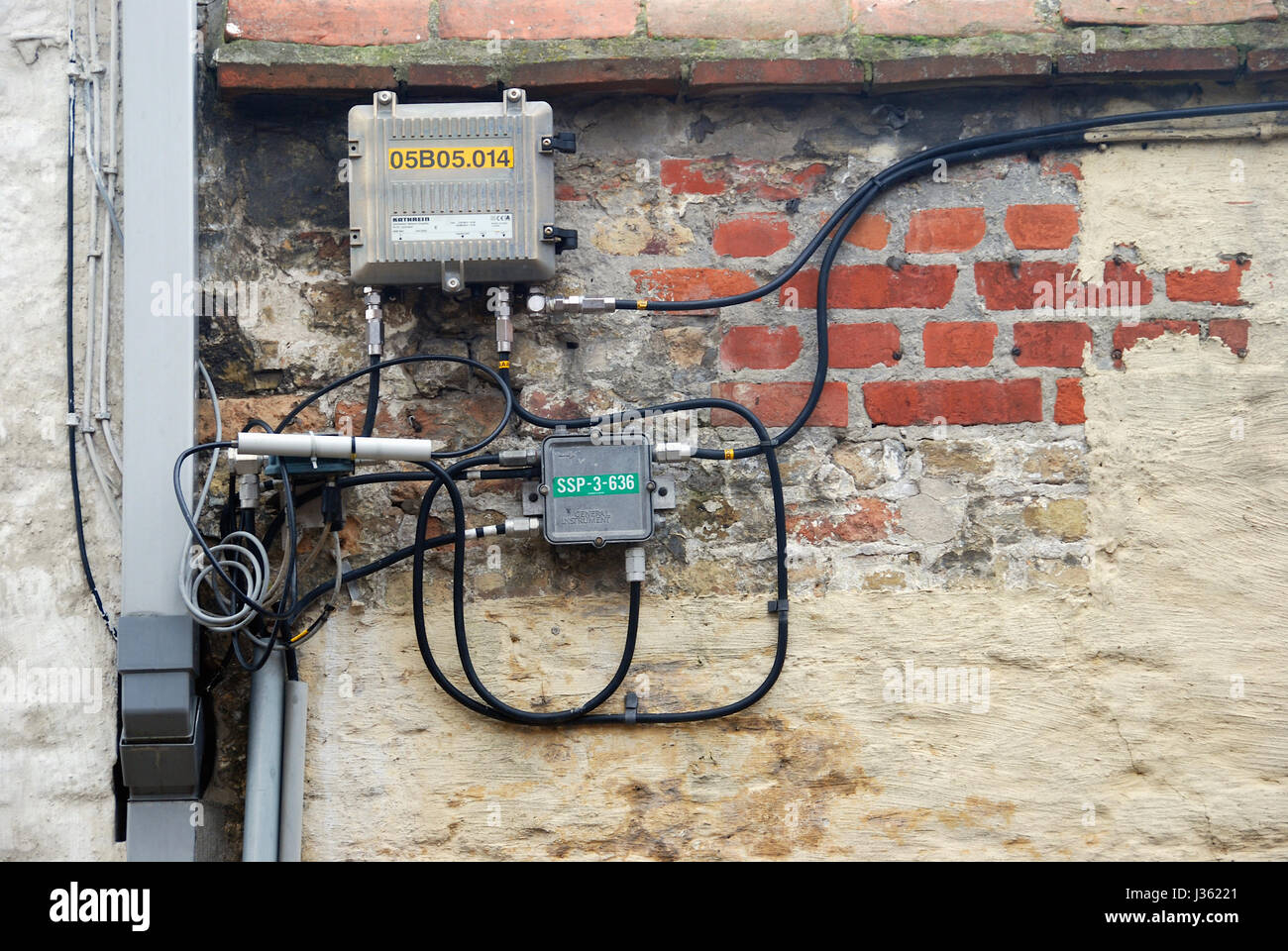 Electrical Wiring On The Outside Of A Building In Bruges Belgium Wall