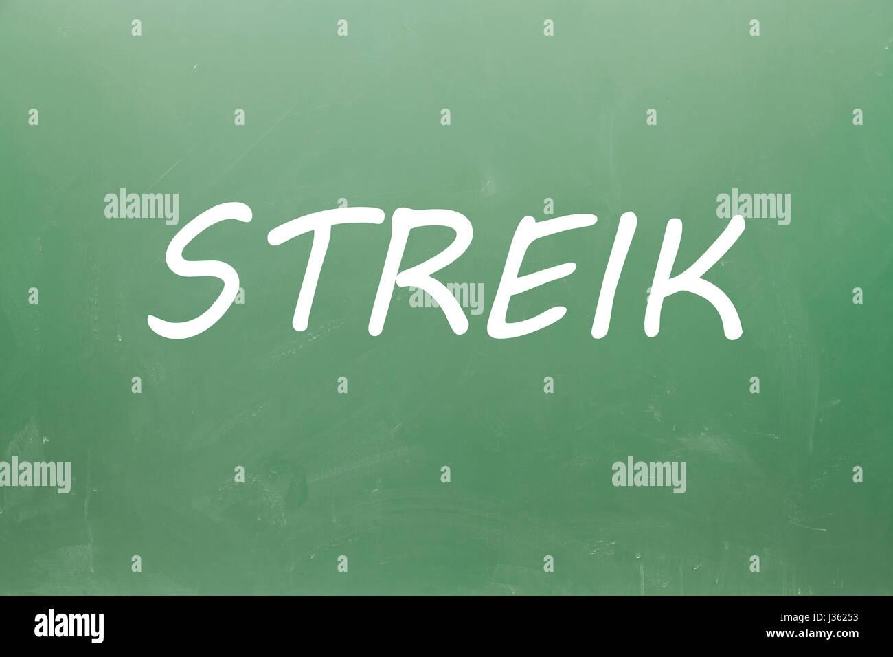 Streike (strike in german) written on blackboard Stock Photo