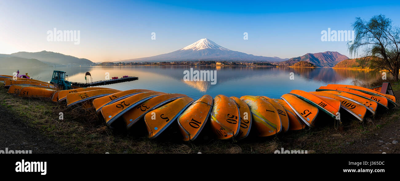 Panorama of mountain fuji with reflection and group of orange boat in foreground lake kawaguchi japan - Stock Image