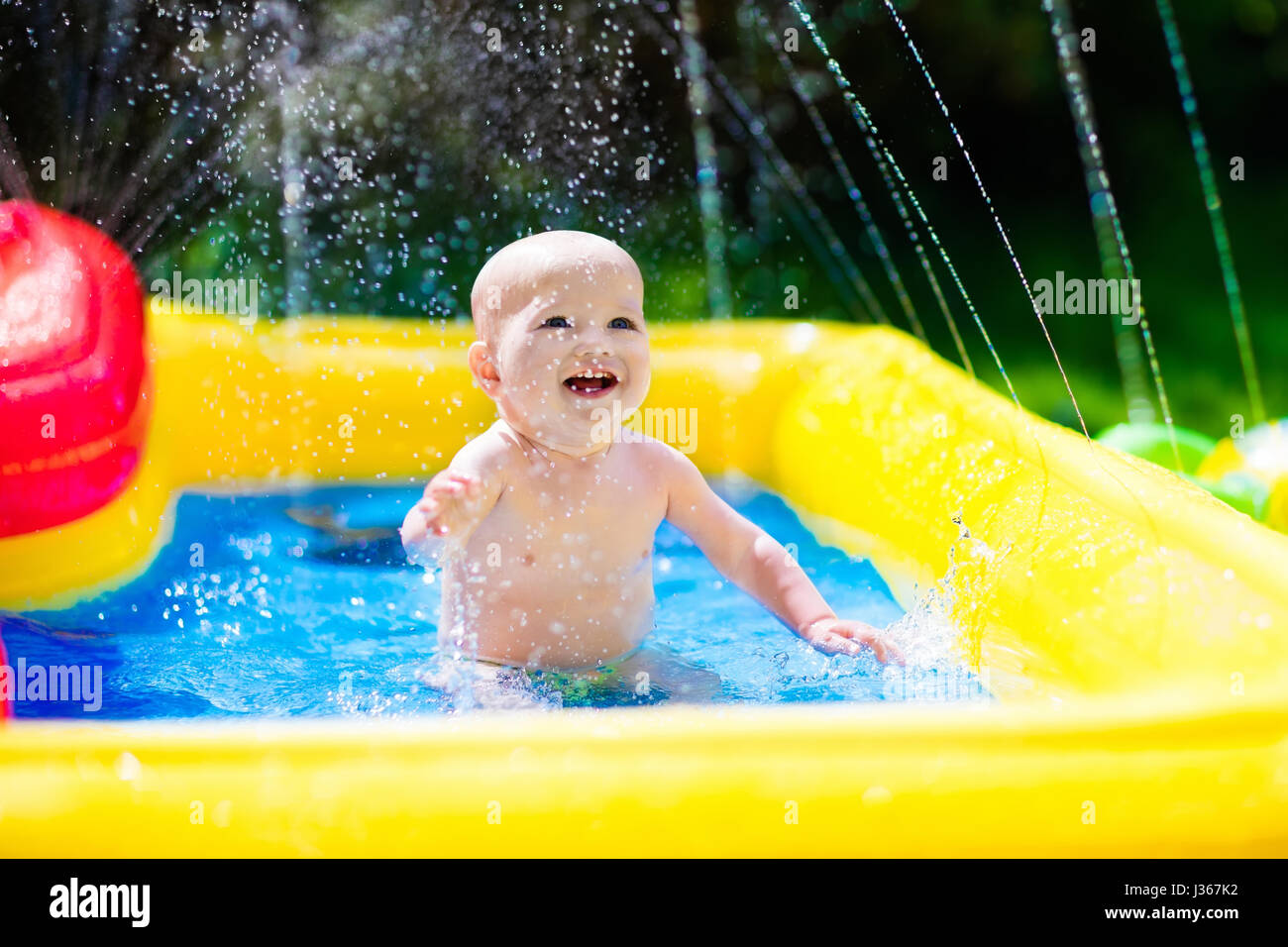 Children Playing In Inflatable Baby Pool Kids Swim And