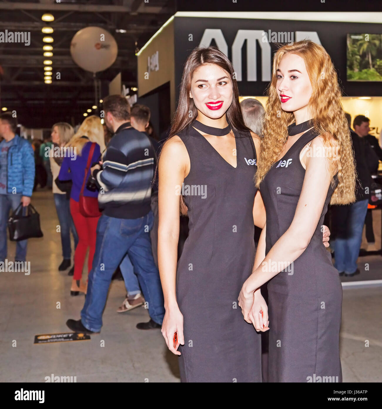Moscow, Russian Federation - April 22, 2017:  Two representative models  at photofurum trade show and exhibition - Stock Image