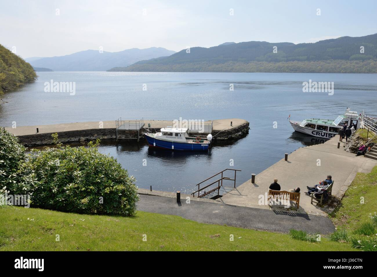 Overlooking Inversnaid pier on a calm sunny spring day on Loch Lomond, Scotland, UK - Stock Image