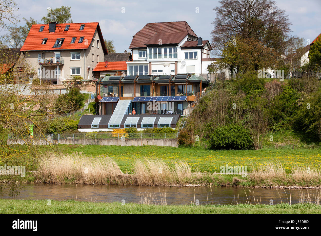 Rear of the houses on the banks of the River Weser, Bodenfelde, district of Northeim, Lower Saxony, Germany - Stock Image