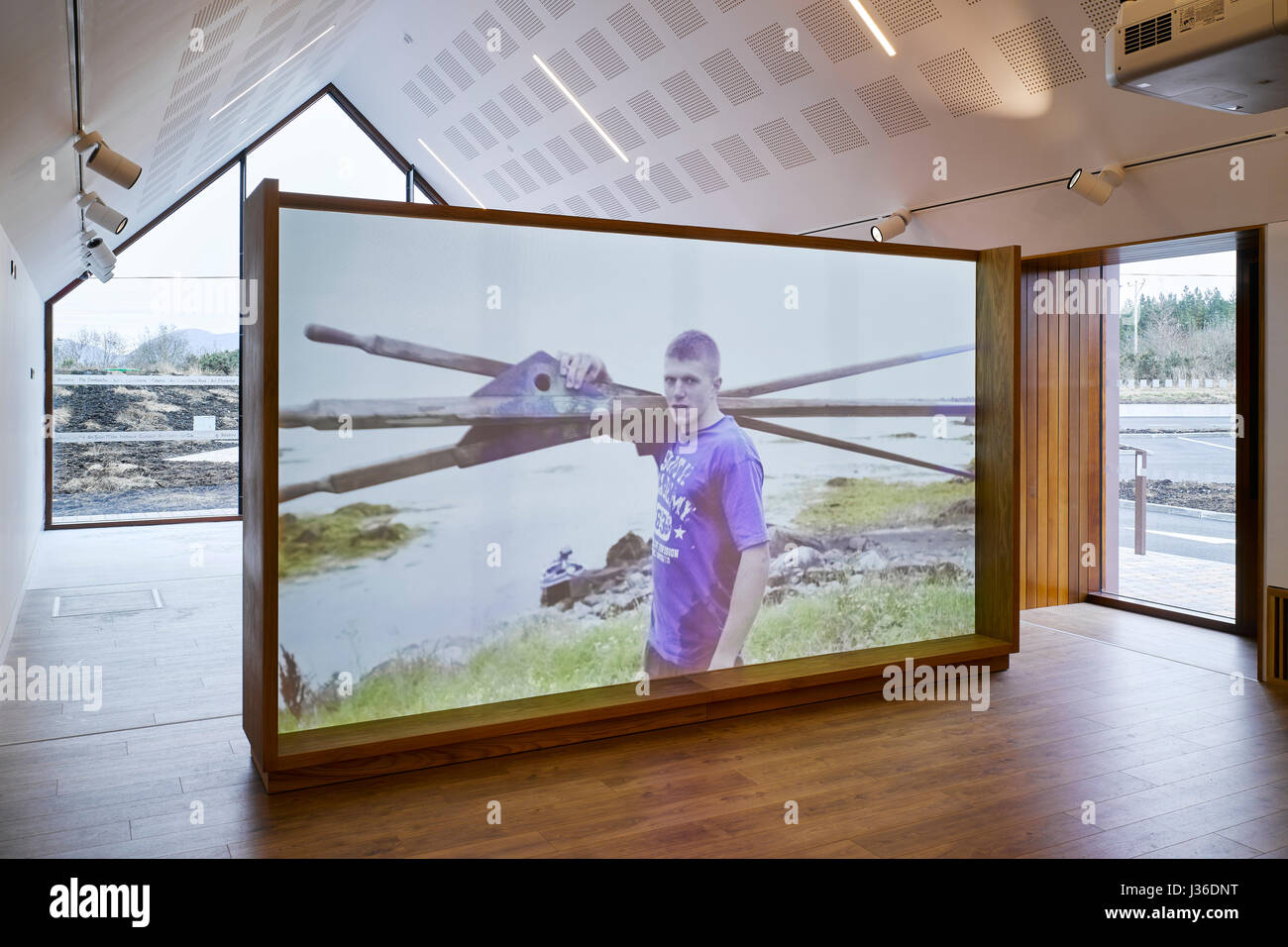 Interior view of exhibition space showing video on gaeltacht life. Pearse Visitor and Cultural Centre, Connemara, - Stock Image