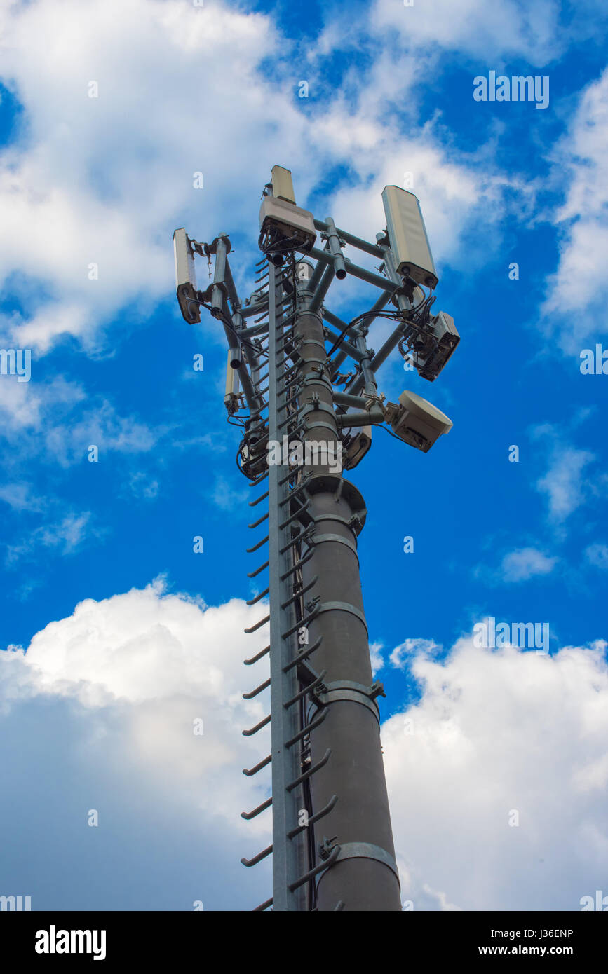 Communication repeater tower, unusual low angle view - Stock Image