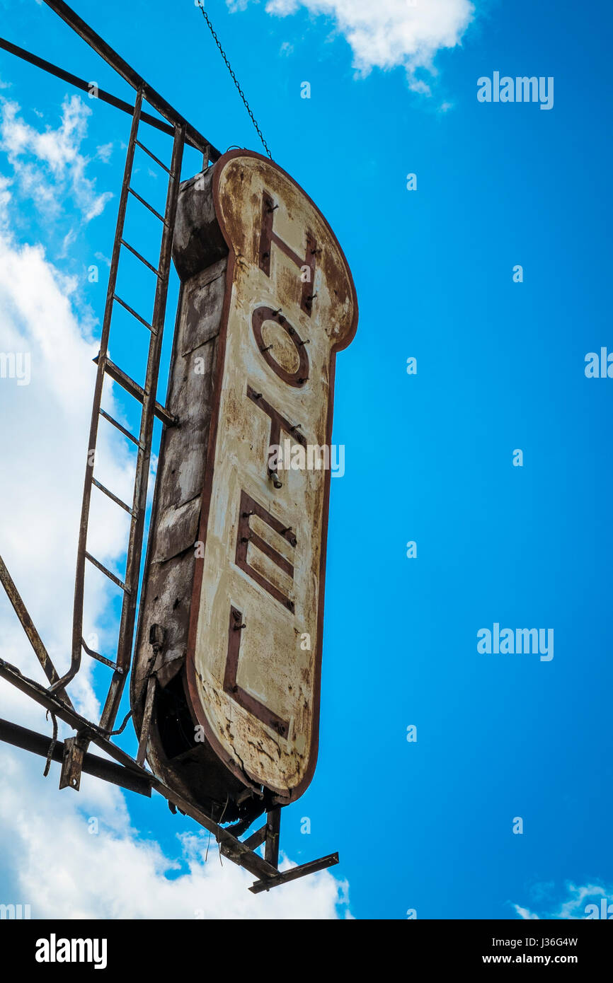 Old, decrepit, weathered sign for a hotel - Stock Image
