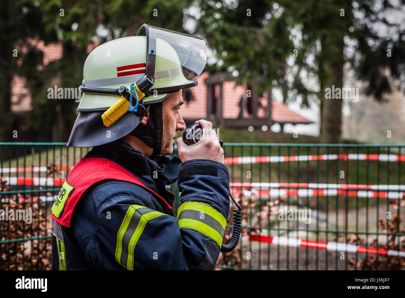 Firefighter used a walkie talkie in action - HDR - Stock Image