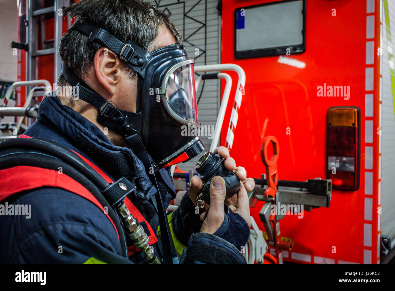 Firefighter in action with respiratory protection mask - HDR - Stock Image