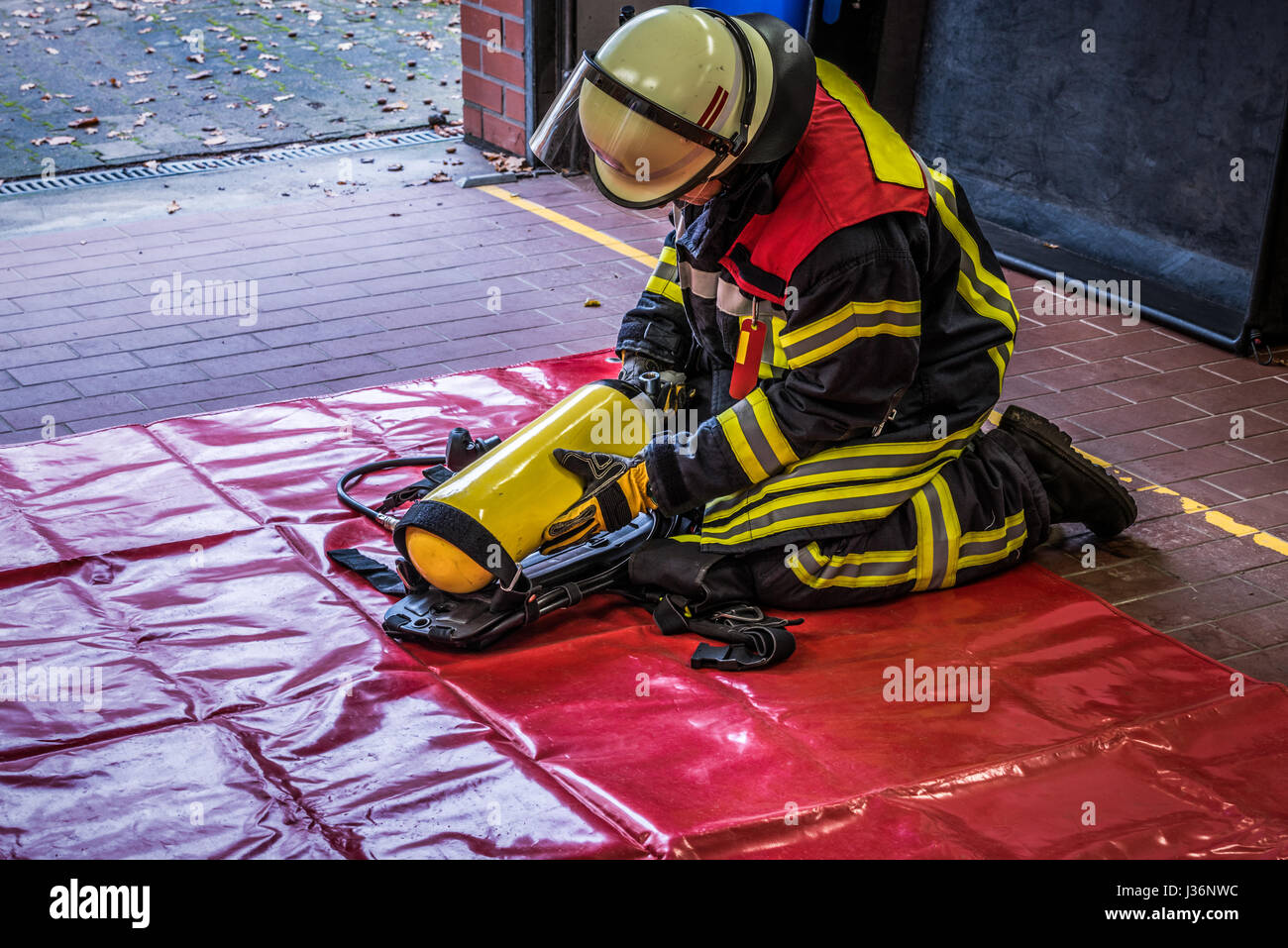 Firefighter in action with oxygen tank - HDR - Stock Image