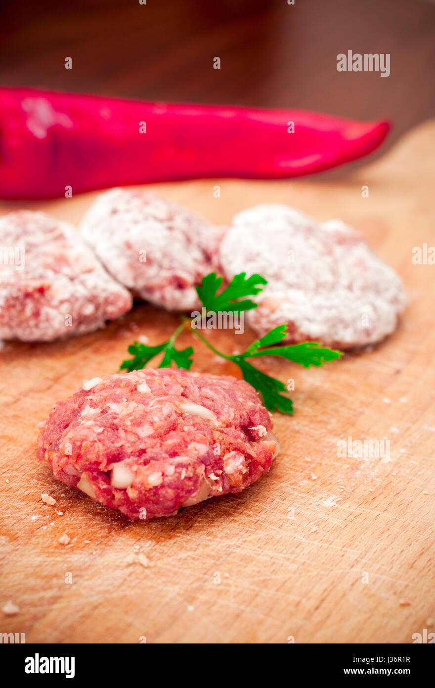 meatballs and red pepper and parsley - Stock Image