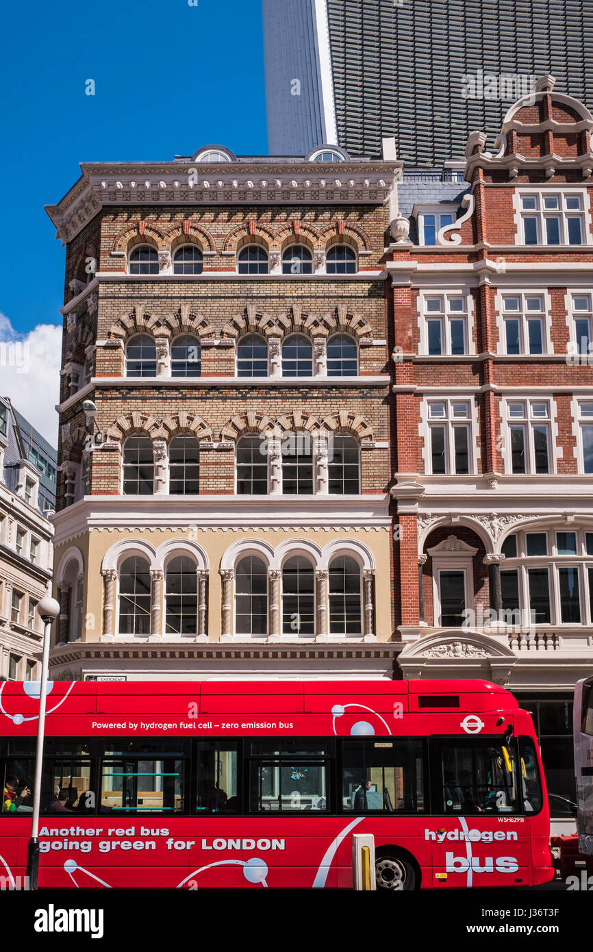 Red Hydrogen powered bus going through the City of London, England, U.K. - Stock Image