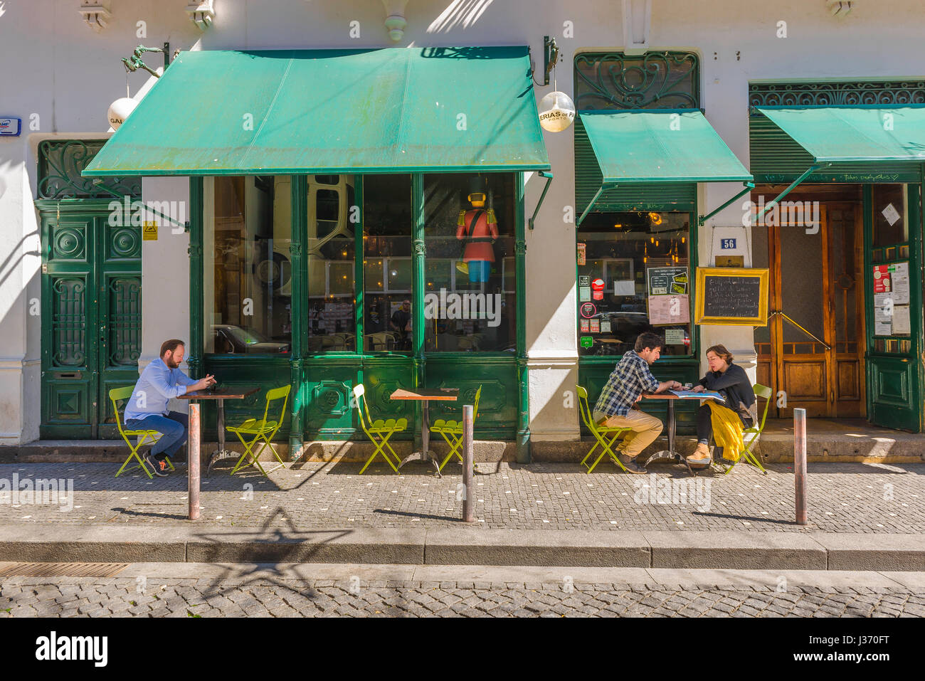 Cafe Porto Portugal People Sit At Tables Outside A Bar In Quiet Street The Center Of