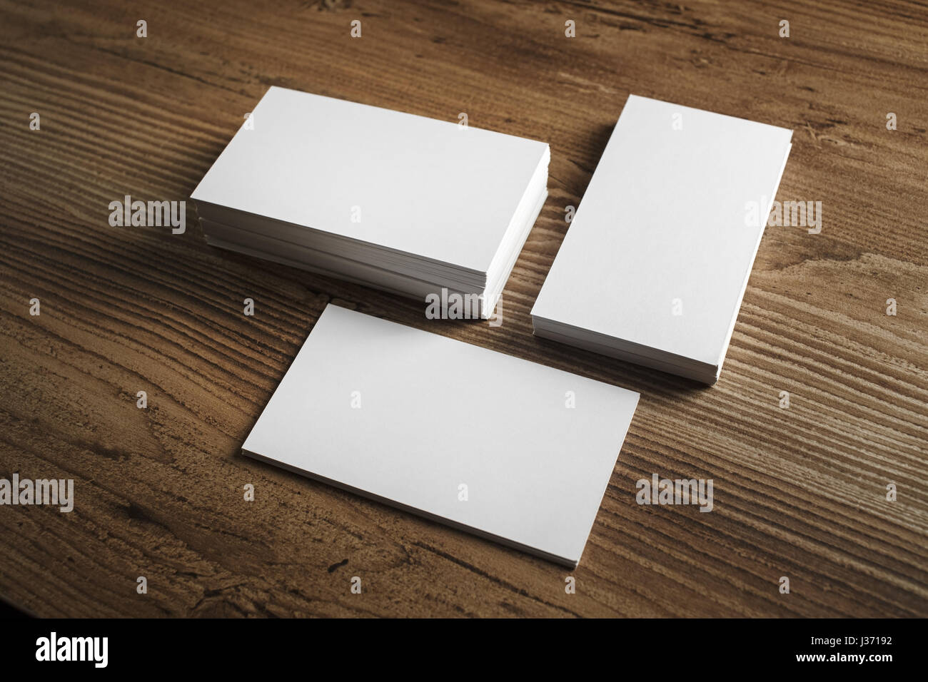 Photo of blank business cards blank business cards on wooden table photo of blank business cards blank business cards on wooden table background template for id mockup for branding identity reheart Image collections