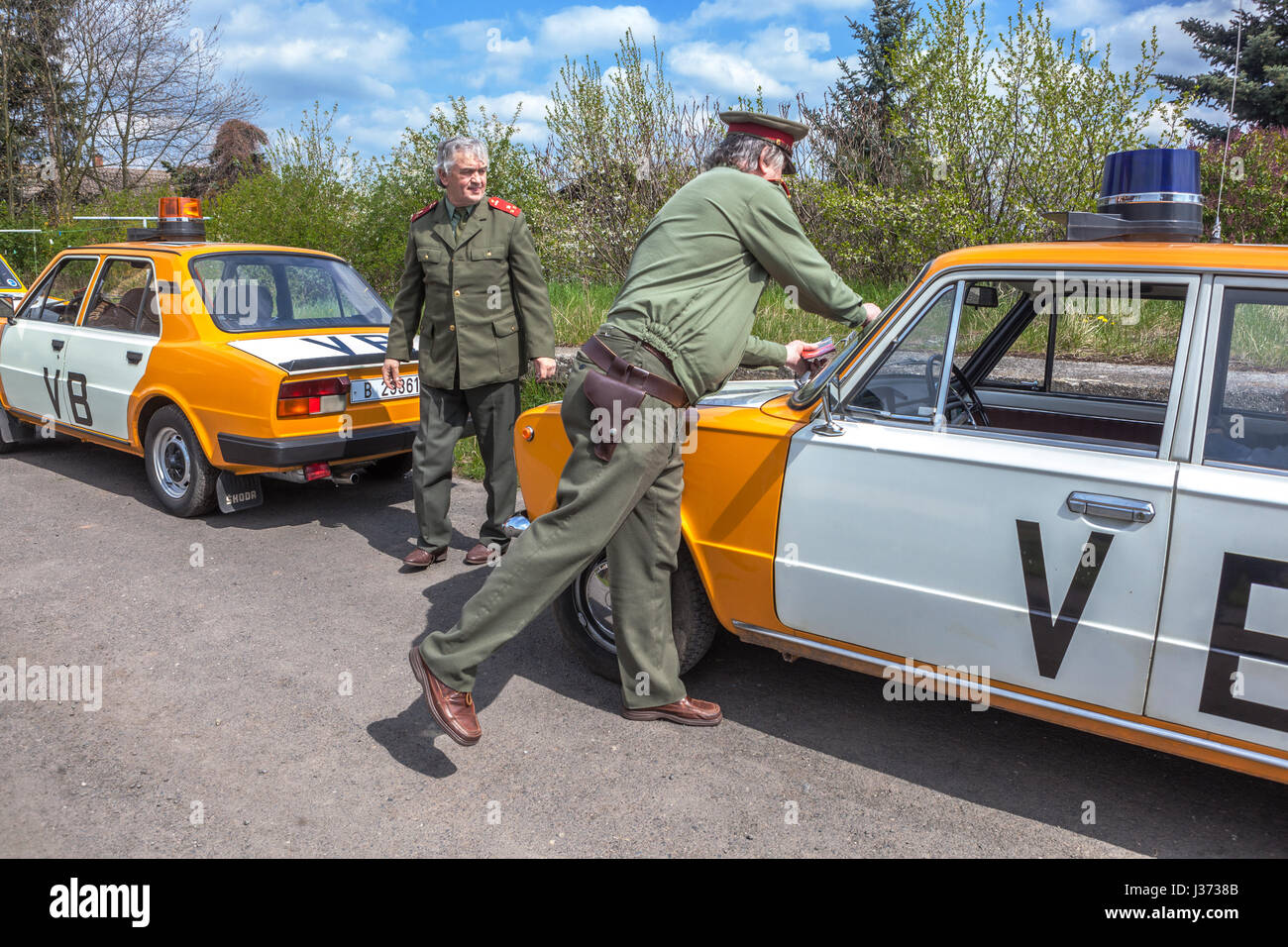 Persons in uniform and cars in the color of the Czechoslovak Police ...