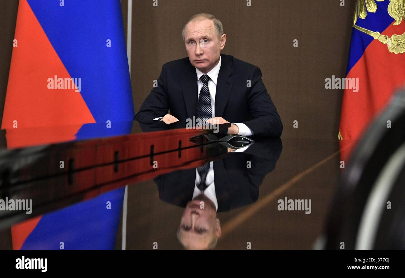 Russian President Vladimir Putin during a video conference to discuss wildfires in Siberian from his Black Sea residence - Stock Image