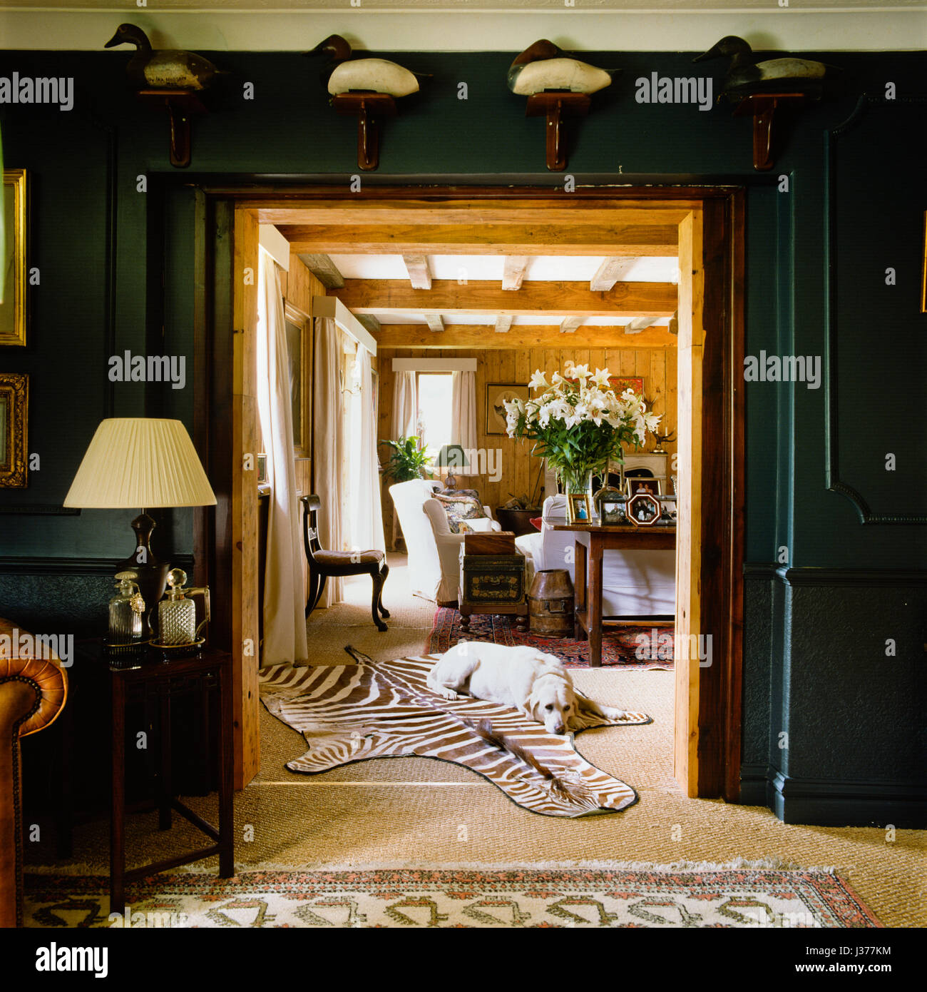 Rustic style doorway and living room. - Stock Image