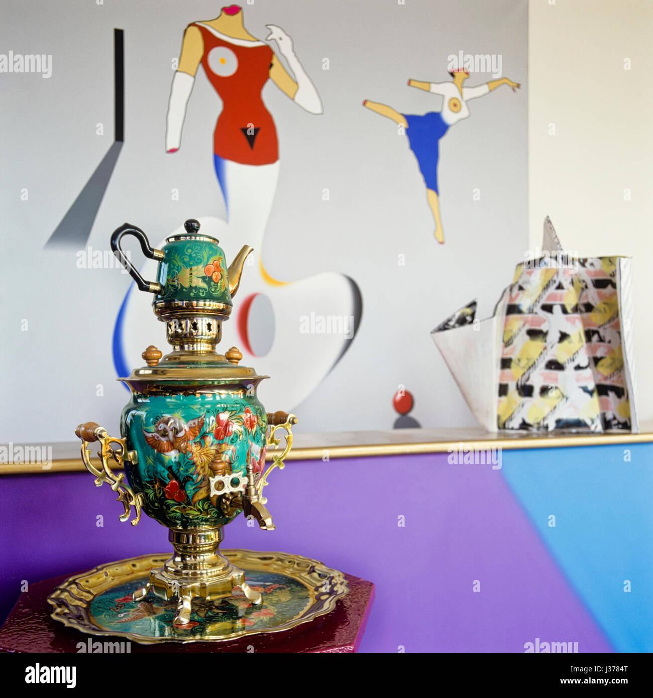 Tea pot beside painted wall. - Stock Image