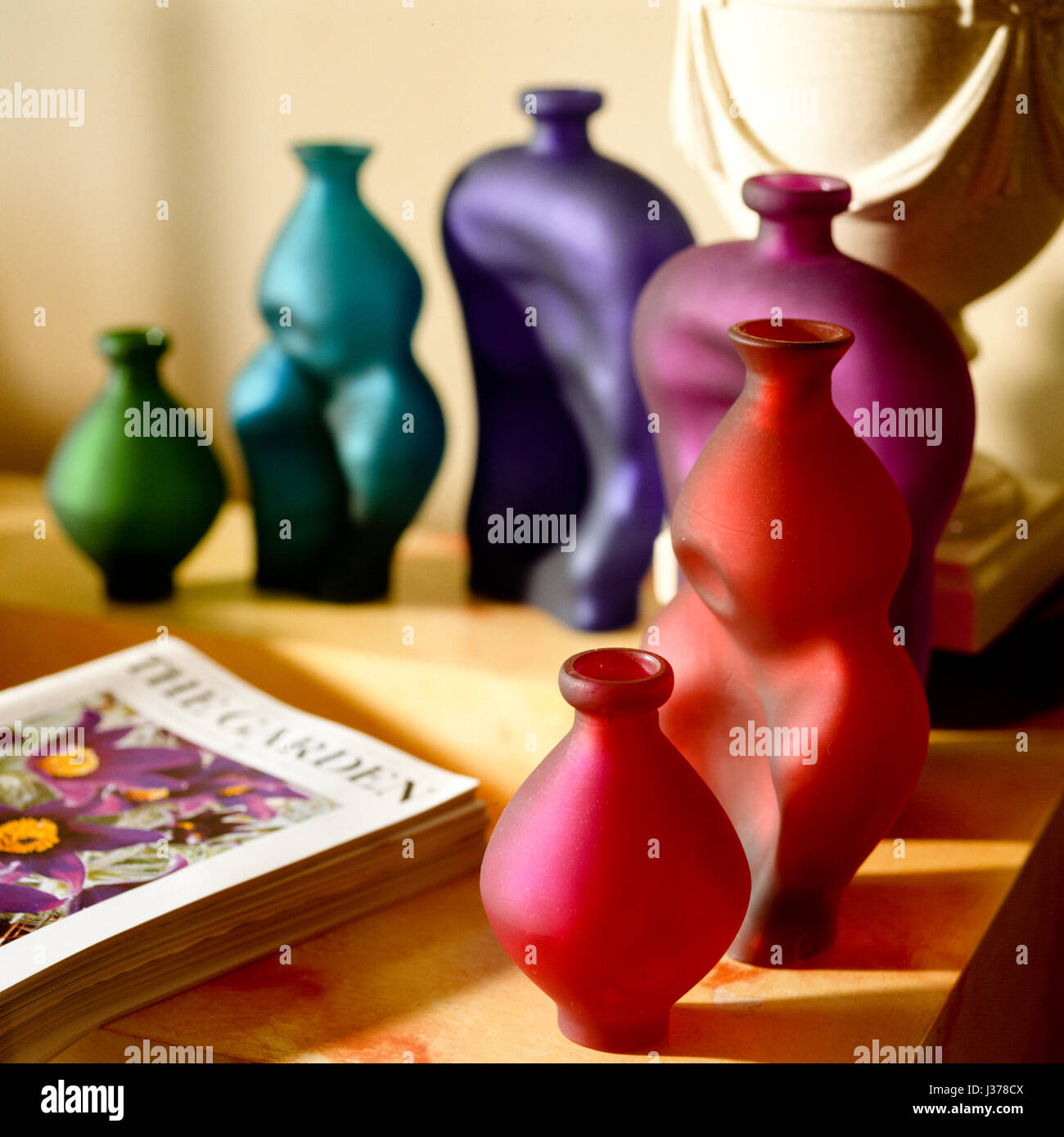 Colored vases and book. - Stock Image
