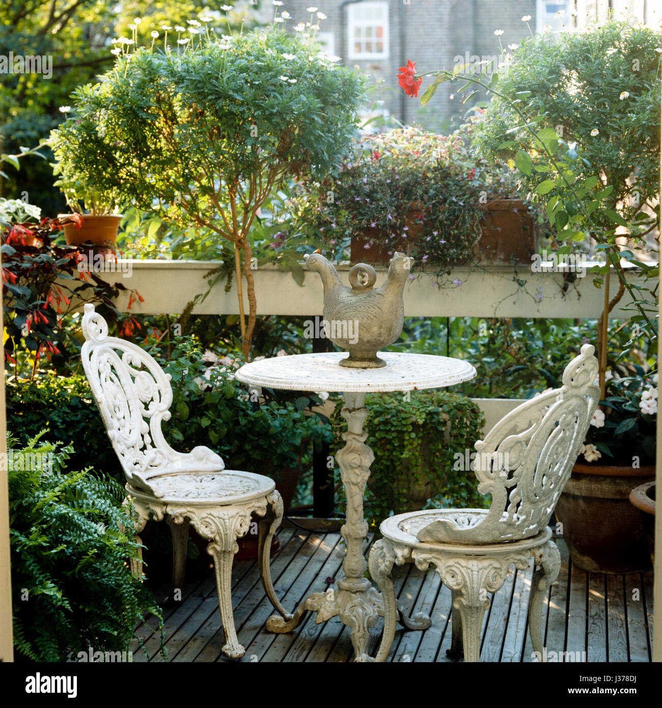 Table and chairs in back garden. - Stock Image