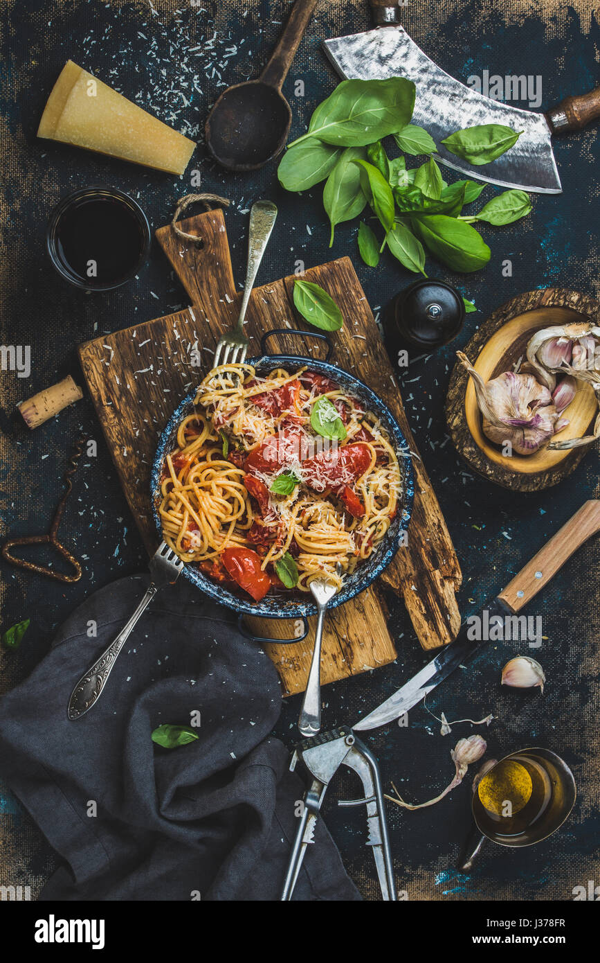 Spaghetti with tomato and basil and ingredients for making pasta - Stock Image