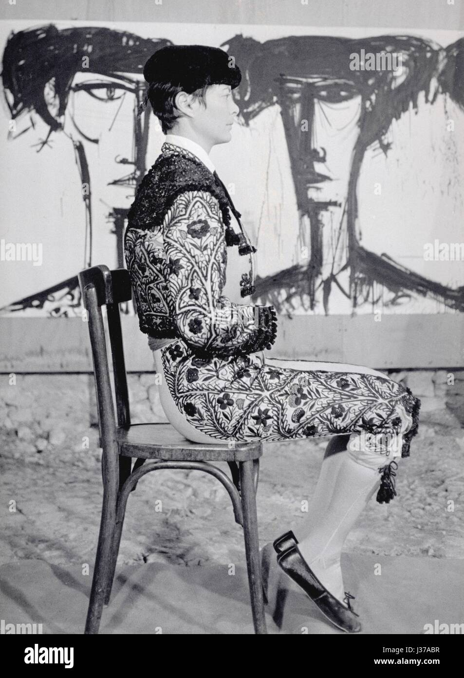 Annabel Buffet, wife of the painter Bernard Buffet, in a torero costume.   Canvas by Bernard Buffet in the background. - Stock Image