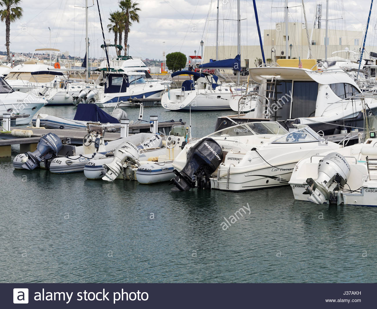 four boats tied up at floating pier with outboard motors, Cascais Marina, Portugal - Stock Image