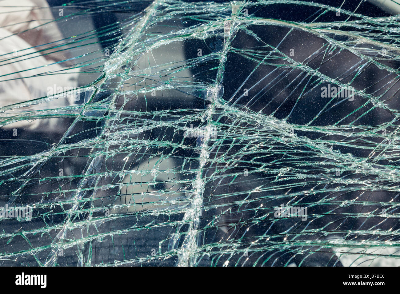 Crashed windshield of a car after accident - Stock Image