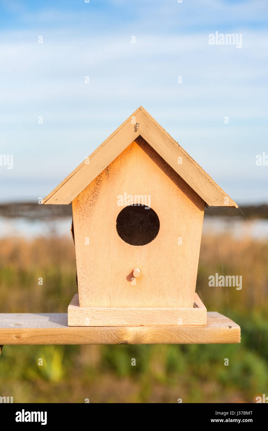 Close up of tiny and colorful wood house. Illustration for Real Estate or Construction. Stock Photo