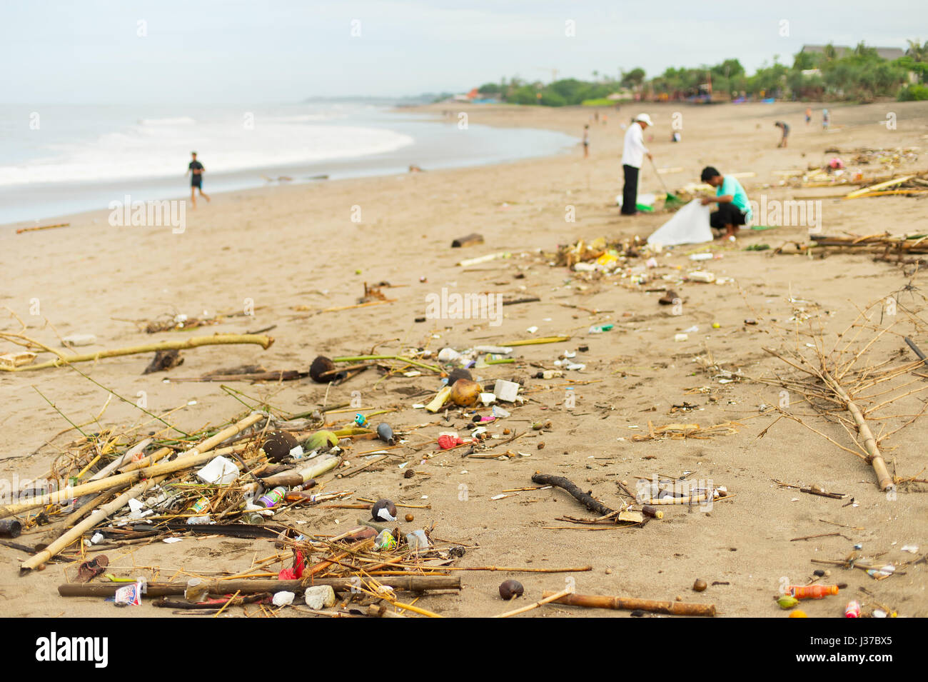 Lots of garbage on the ocean beach. Bali island, Indonesia - Stock Image