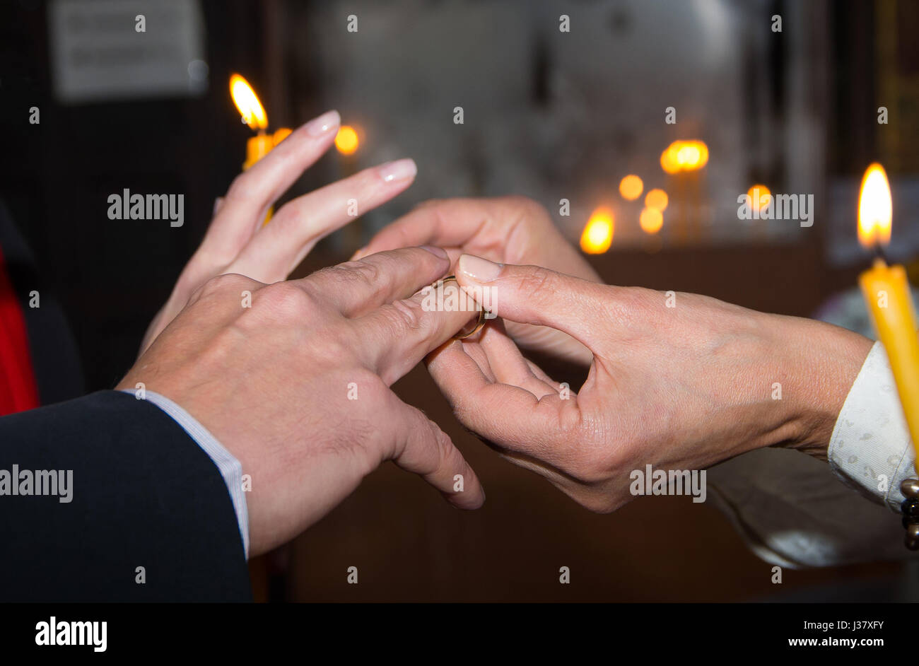Ritual placement of wedding rings in a Christian church - Stock Image