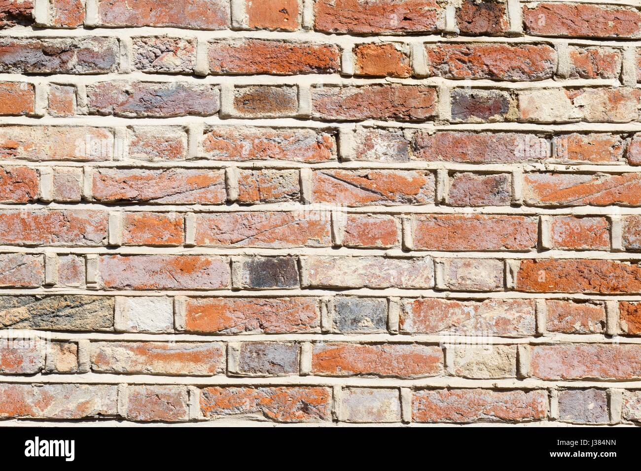 Lime mortar brick wall background showing repointing Stock
