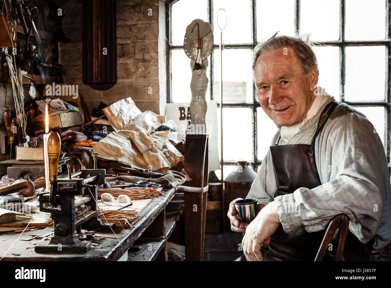Leather worker at Blists Hill Victorian Museum, Ironbridge, UK - Stock Image
