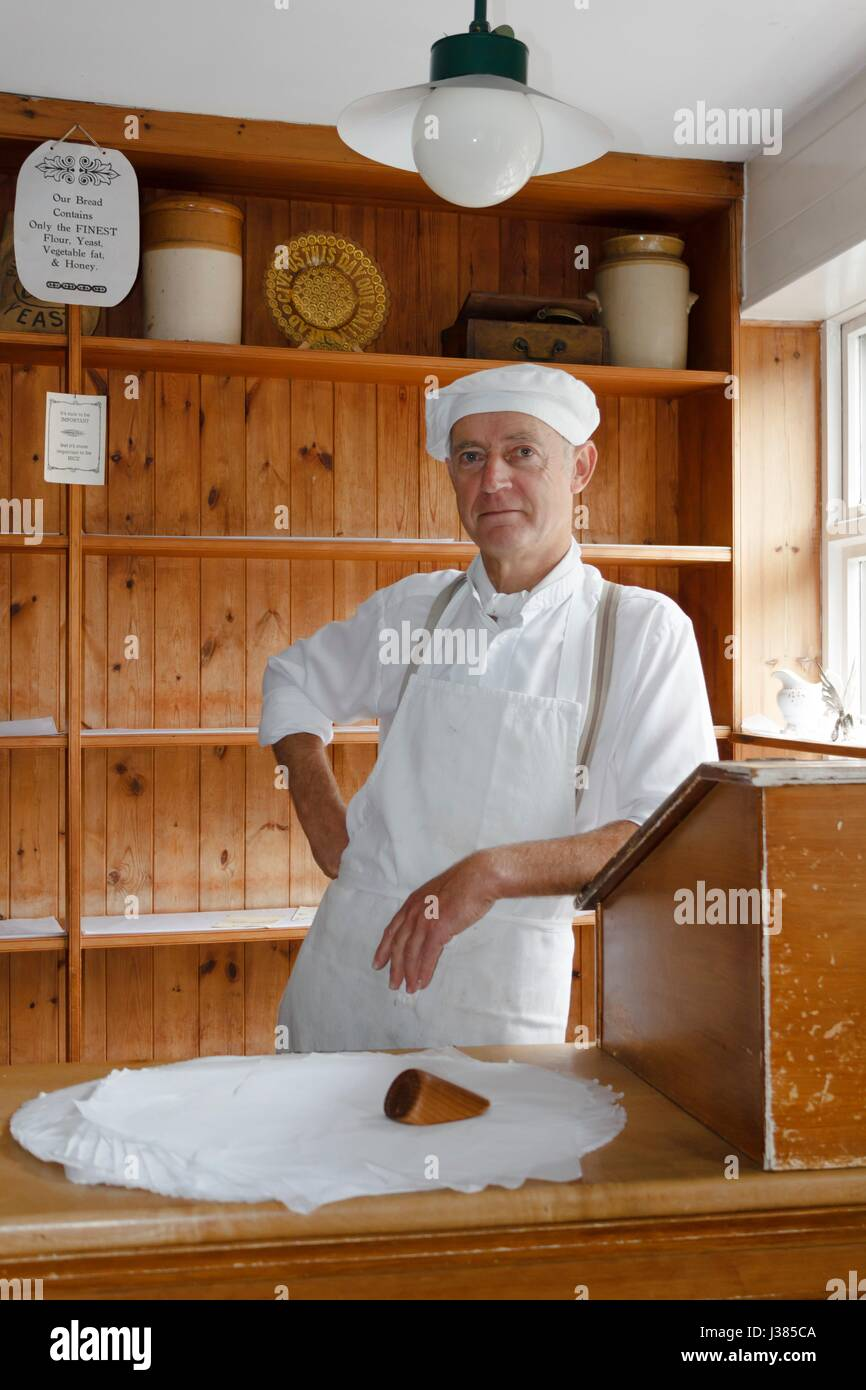 Baker at the Victorian Bakery shop store in Blists Hill Museum, Ironbridge, Shropshire, UK - Stock Image