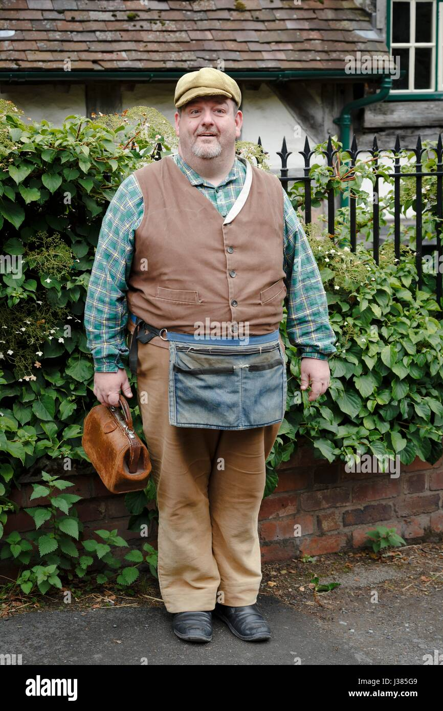 Tradesman in traditional costume at Blists Hill Victorian Museum. Ironbridge, Shropshire, UK - Stock Image