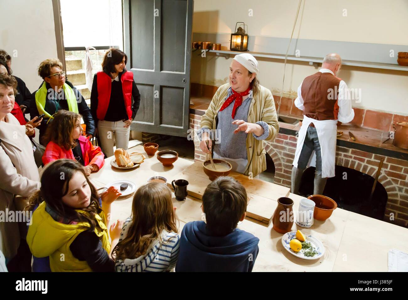 Chefs in traditional dress demonstrate cookery at the Royal Kitchens, Kew Gardens, London, UK - Stock Image