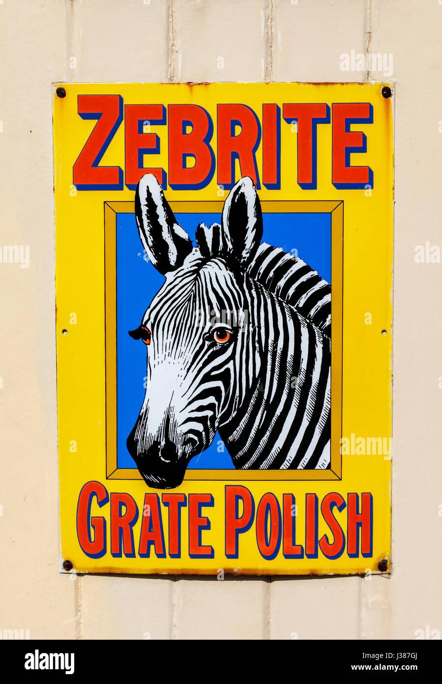 Old-fashioned, vintage metallic tin advertisement for Zebrite Grate Polish at Tenterden Town Station, Tenterden, - Stock Image