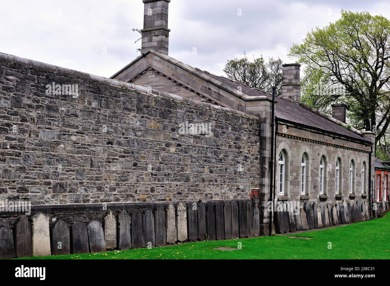 Tombstones of British military personnel who died in the Dublin area in the 19th and early 20th century at the Church - Stock Image