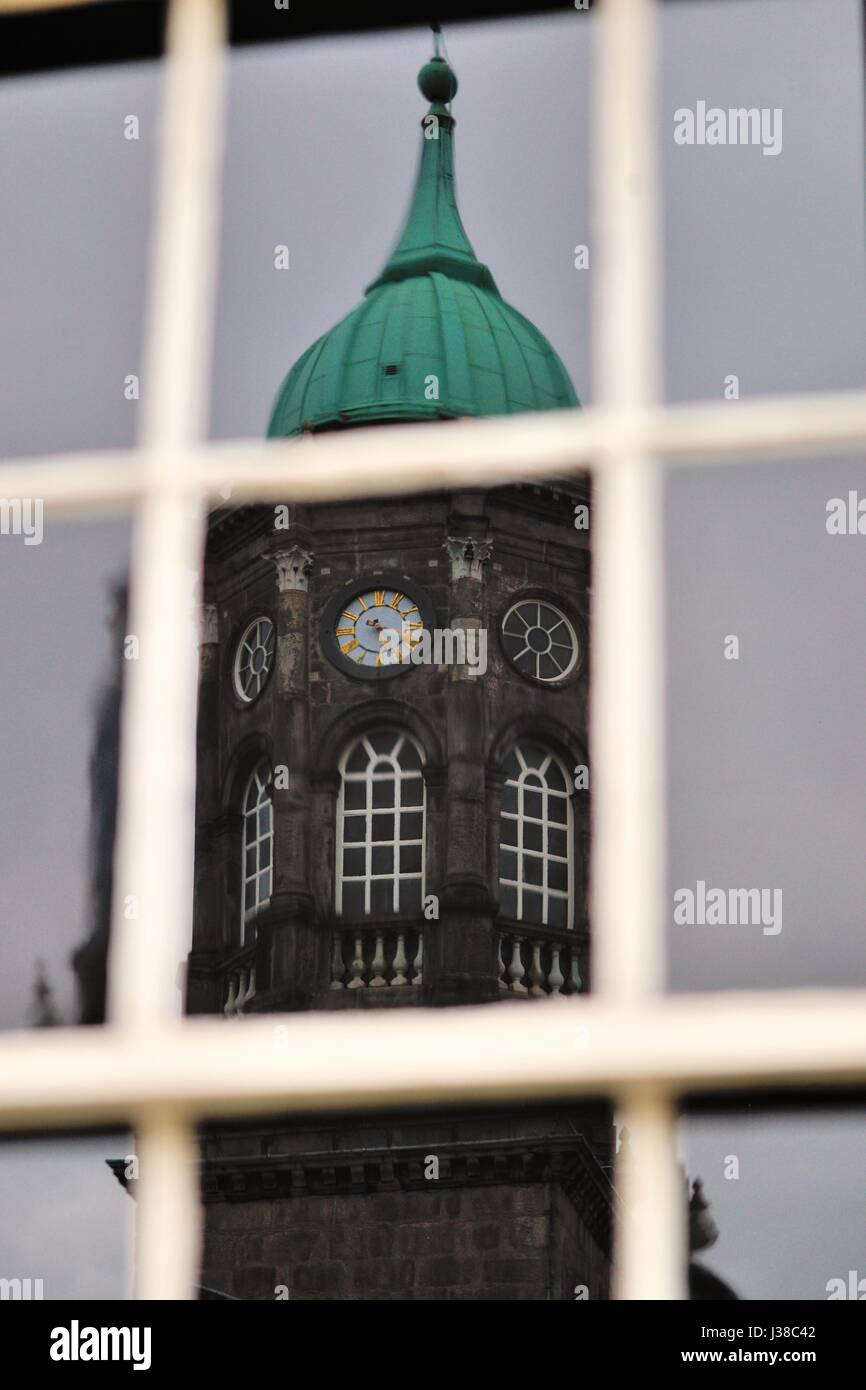 A reflection of Bedford Tower in a window at Dublin Castle. Bedford Tower is built on a base that was an original Stock Photo