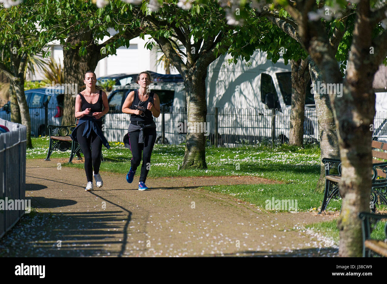 Two women jogging Keep fit regime Jogging Joggers Running Determined Exercising Healthy lifestyle Fitness Runners - Stock Image