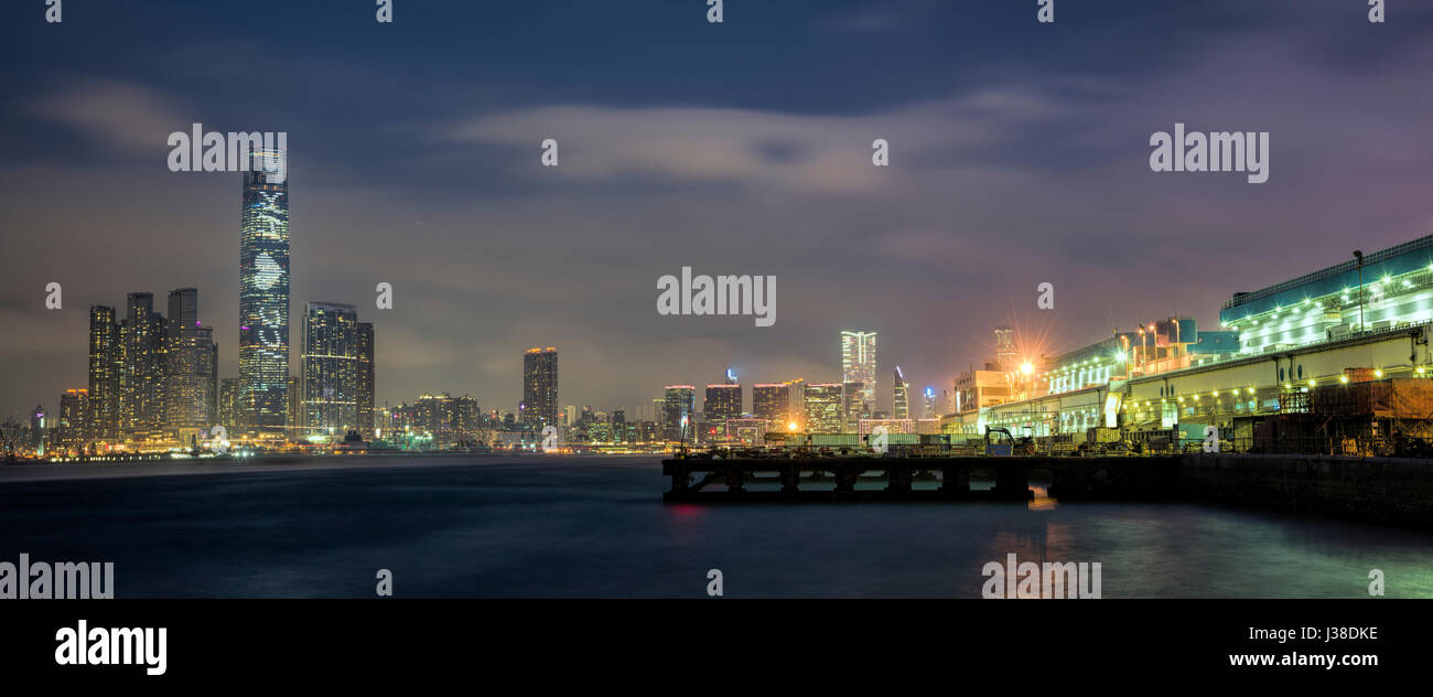 Hong Kong wholesale vegetable market in Kennedy Town, and the International Commerce Centre, ICC, Hong Kong, China. - Stock Image