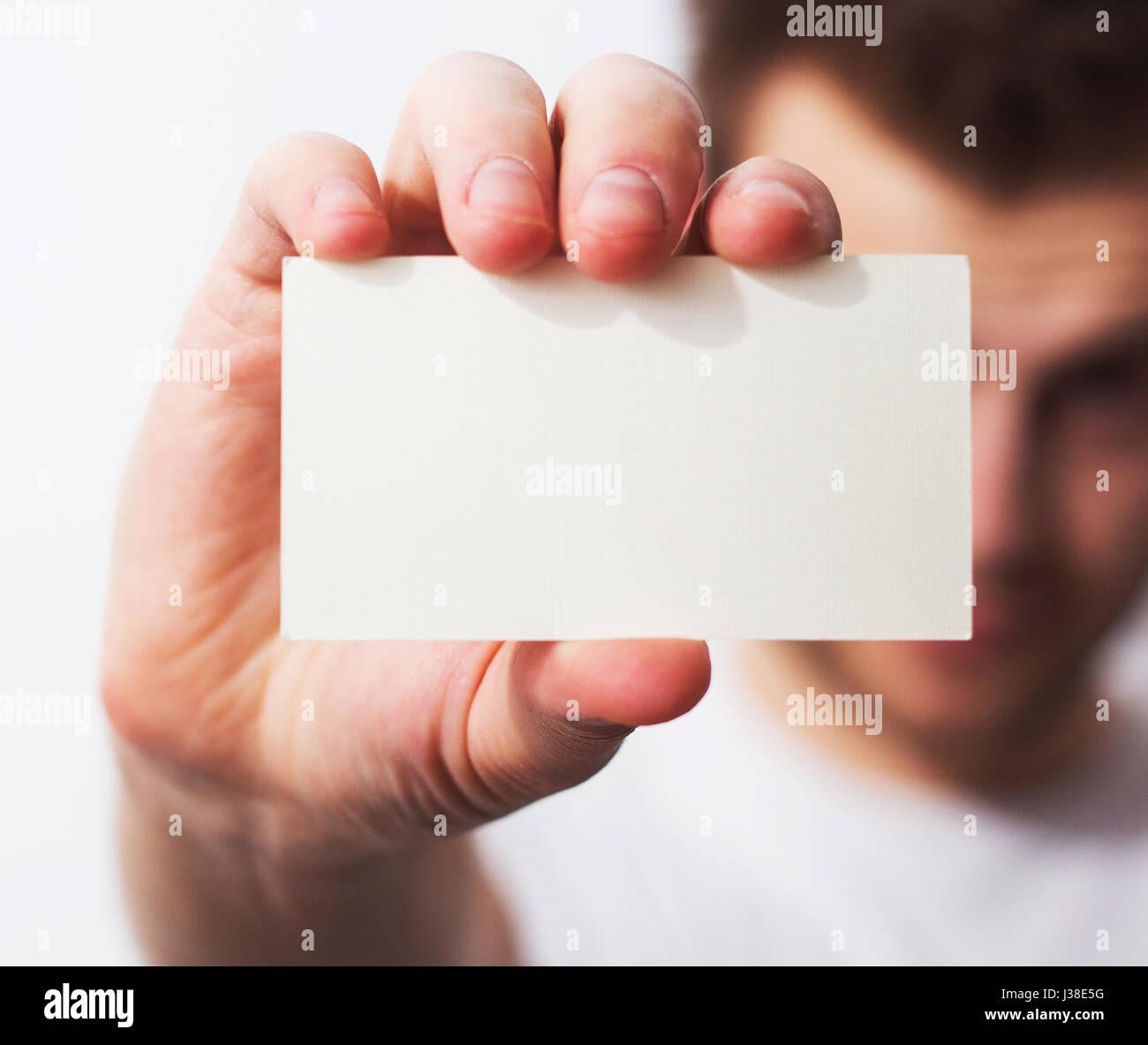 Business man, guy, designer, freelancer handing a parchment visiting ...