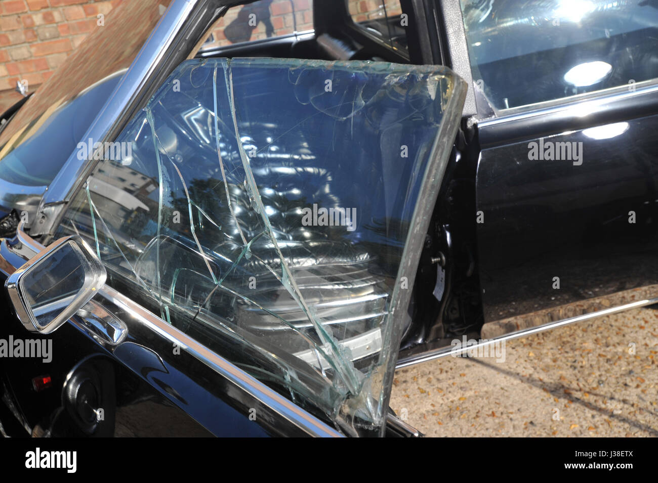 Bullet proof and bullet damaged Chrysler Imperial which Iranian Royal family members escaped in during the 1979 - Stock Image