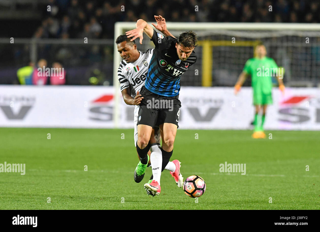 Soccer players in action, FC Juventus Alex Sandro and Atalanta Bryan Cristante during the italian soccer match, - Stock Image