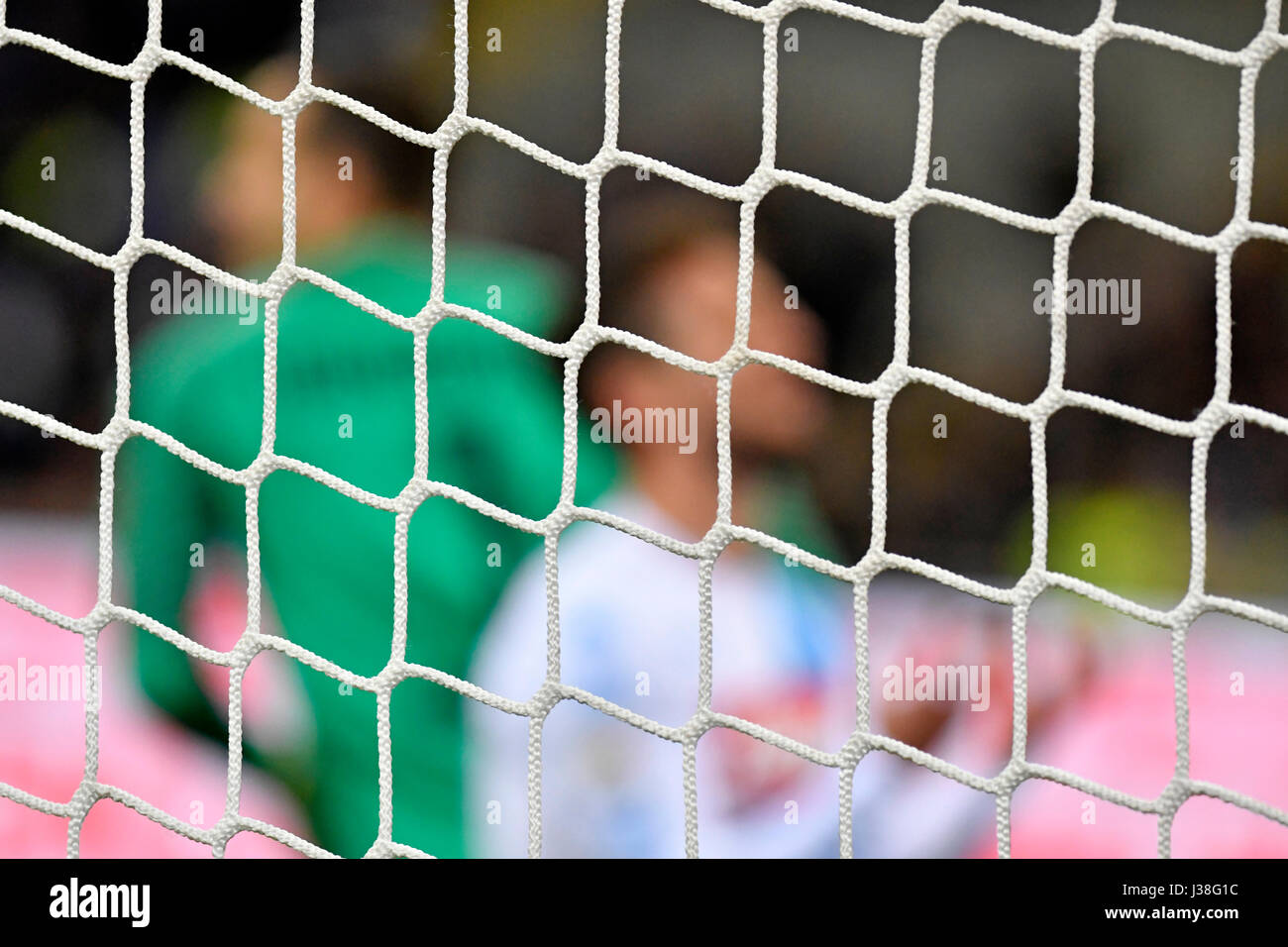 Goal net with soccer players in the background during the italian serie a soccer match FC Internazionale vs Napoli, - Stock Image