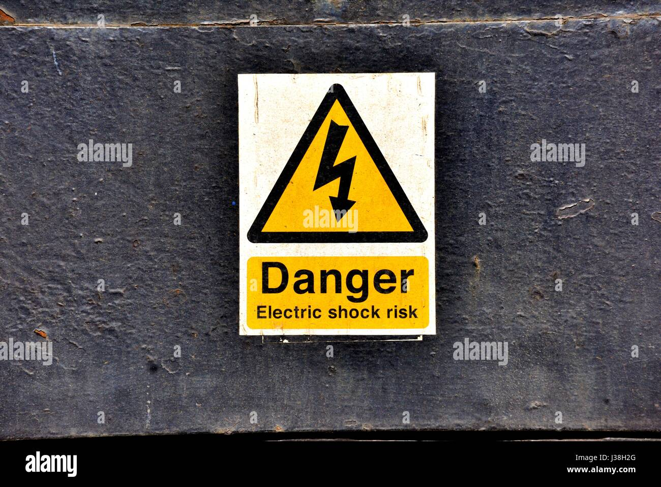 Danger electric shock risk sign - Stock Image
