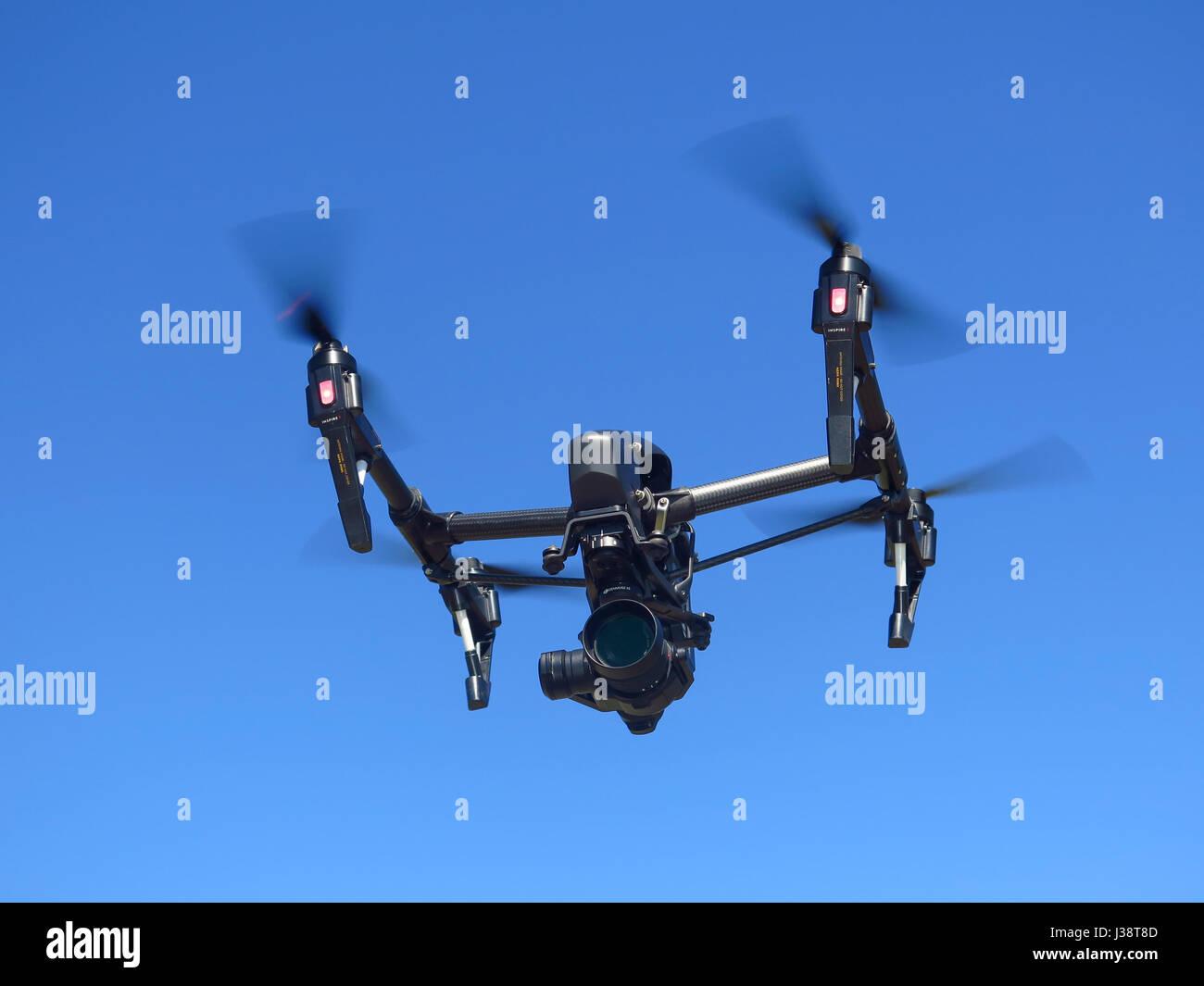 DJI Inspire 1 Pro Black edition drone in flight - Stock Image