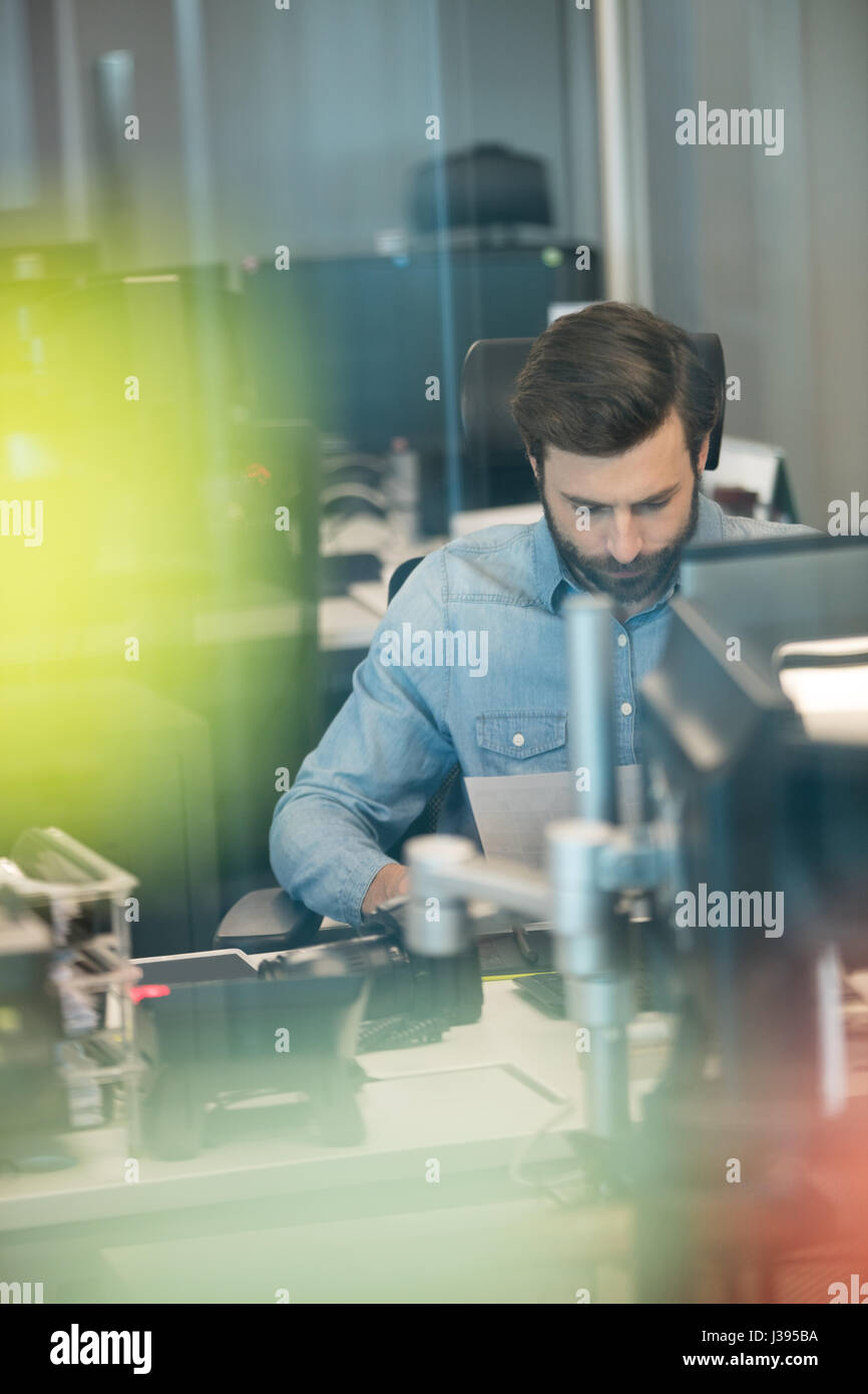 Professional designer working in creative office - Stock Image