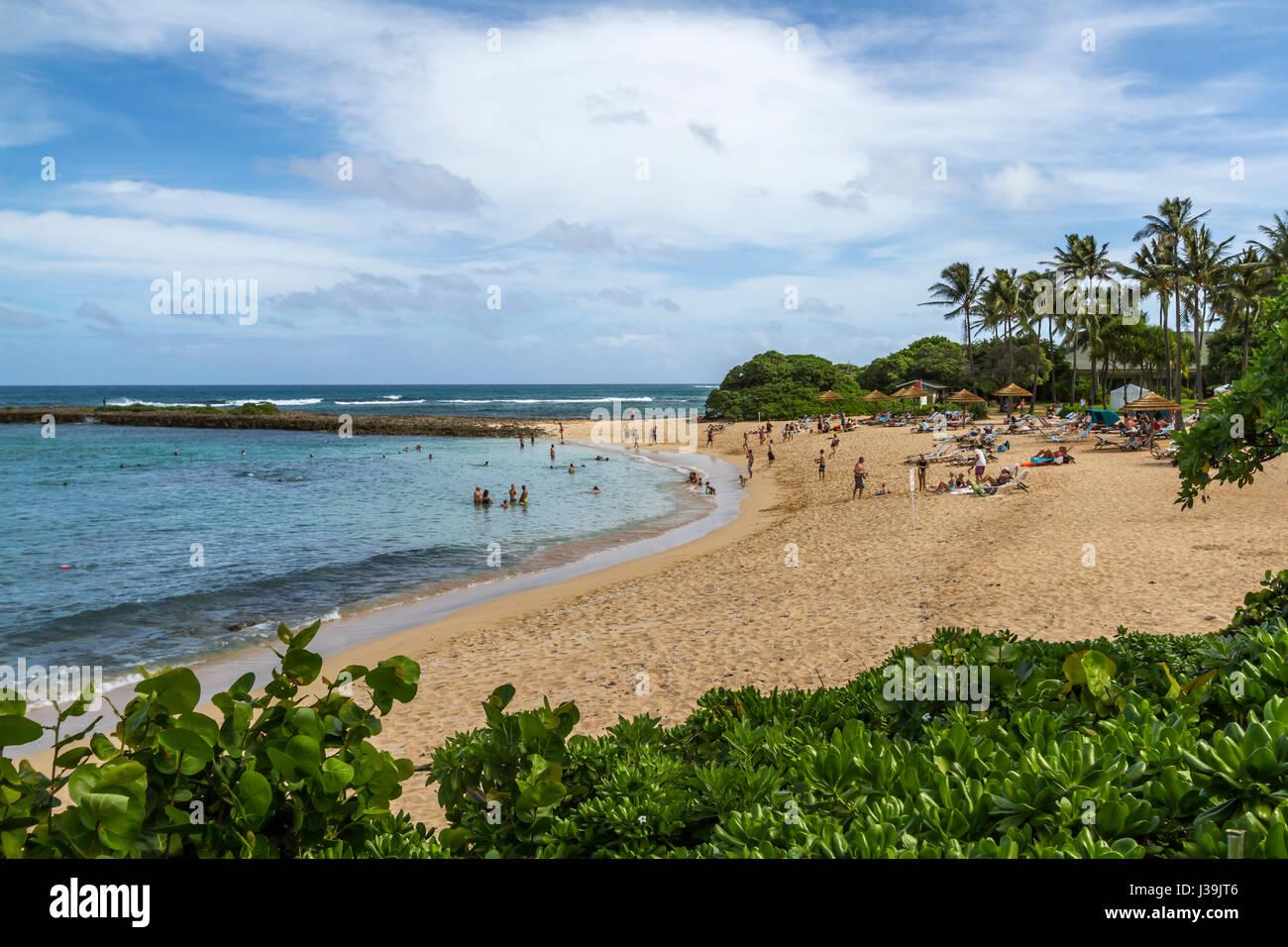November 2, 2105 Turtle Bay Resort beach, Kahuku Hawaii, Tourists enjoying the beach - Stock Image