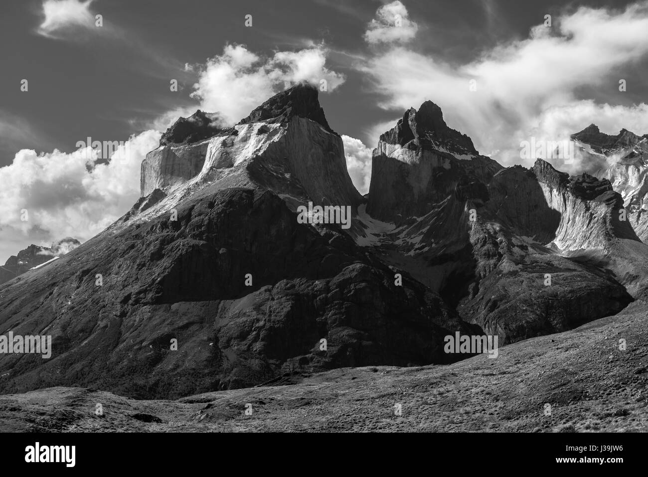 Black and white photograph of the majestic Cuernos (horns) del Paine Andes peaks inside the Torres del Paine national - Stock Image