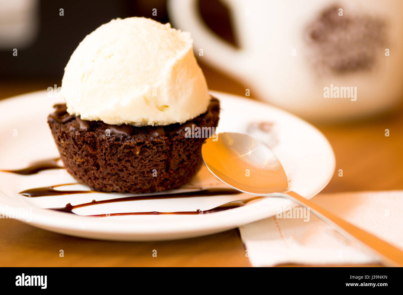 Close Up Of A Delicious Icecream On Top Of A Brownie With A